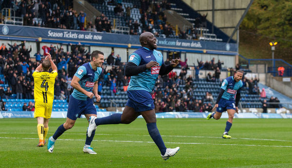 Adebayo Akinfenwa celebrates his 200th career goal